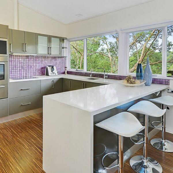 Modern white kitchen renovation and upgrade, finished with caesarstone benchtops. Caesarstone bechtop surfaces come with a 10-year warranty.
