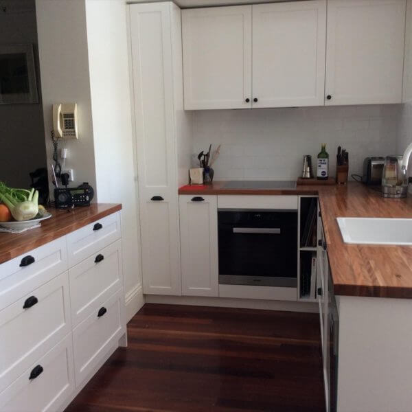 White Classic Contemporary Kitchen with Wooden benchtops and wooden floor