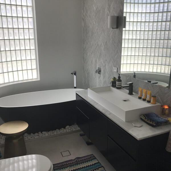 Black, White and Grey modern tiled bathroom, with bathtub