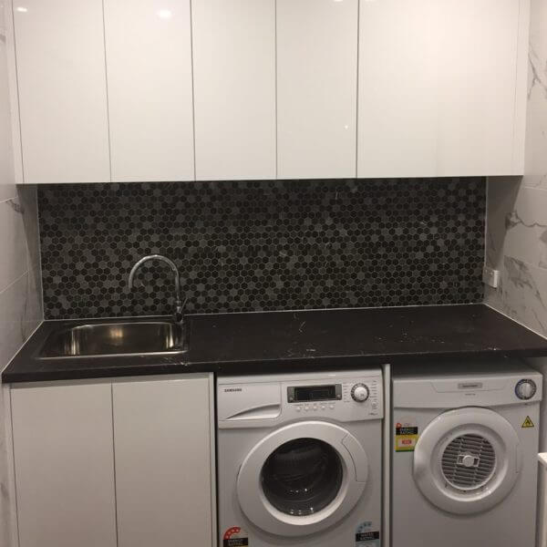 Black and white small modern laundry room
